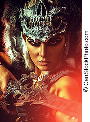 close-up legend - Beautiful bellicose Amazon with a sword in...