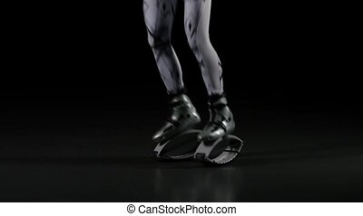 Close-up legs jumping in black background, slow motion
