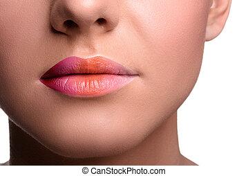 Close up lips shot of young woman posing, showing her tongue