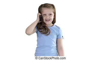 Little cute girl making a phone call while walking on white background.