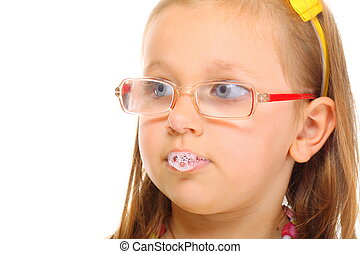 Funny little girl in glasses doing fun saliva bubbles studio shot isolated on white background