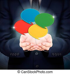 businessman holding colorful speech bubble