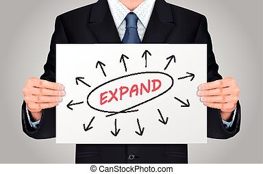 businessman holding expand word poster