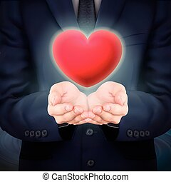 businessman holding red heart symbol