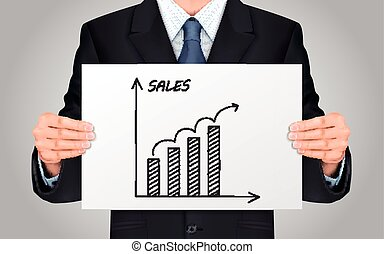 businessman holding sales growth graph