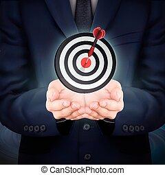 businessman holding target icon