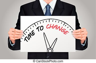 businessman holding time to change poster