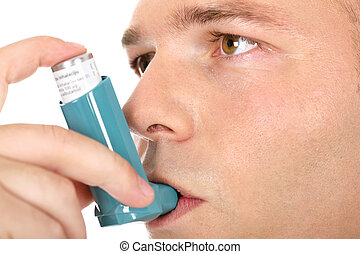 Close up look of a man with pump in his mouth, against...