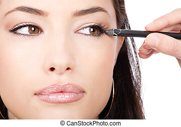 close up look of applying cosmetic pencil