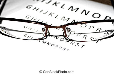 Close-up look of glasses with a letters in the back