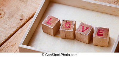 Close up LOVE text sign on wooden