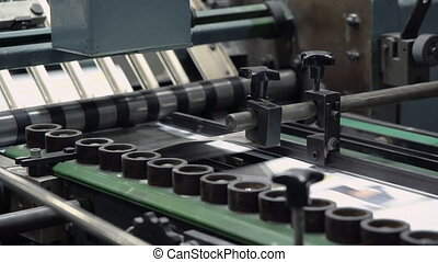 close up machine on print factory - printing newspaper or...
