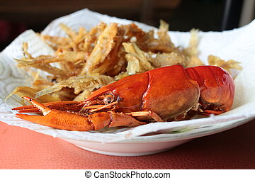 close-up macro boiled crawfish or crayfish and fish fried of...