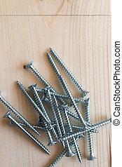 close-up macro photo of pile of screws