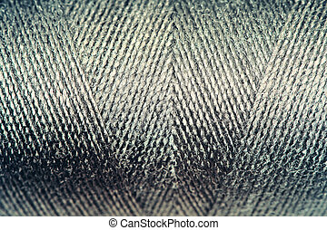 Close up macro photo of threads bobbin