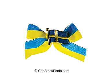 Close up macro view of metal badge in form of swedish flag on blue yellow bow.