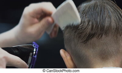 Close up. Male haircut with electric razor. Professional...