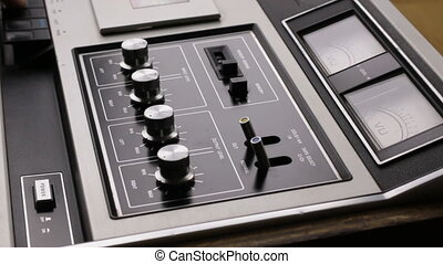 Close-up. Man adjusts and controls a cassette recorder. Retro technique