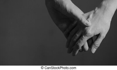 close up man and woman hand touching holding together on...