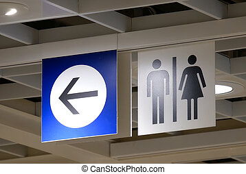 Close up man and woman washroom logo inside Ikea store