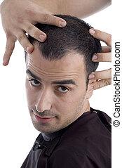 close up man getting head massage