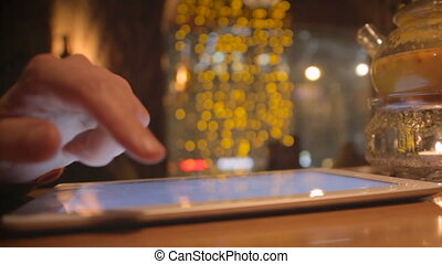Close up man hands using digital tablet touchscreen  in cafe