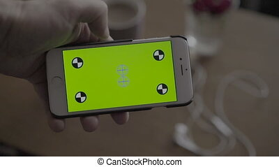 Close Up Man Holding Smartphone With Green Screen
