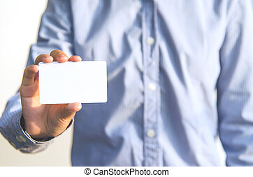 Close Up man holding white business card