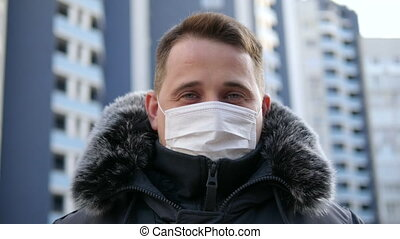 Man in medical mask against viruses and infections. Coronavirus 2019-ncov covid-19 concept.