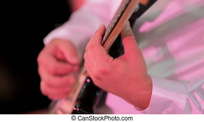 Close-up: Man Playing Guitar