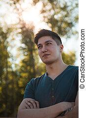 Close up man portrait outdoor.
