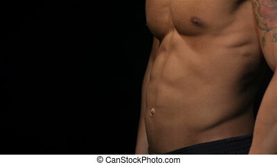 Close up man showing a perfect ABS