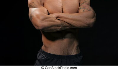 Close up man showing his muscular torso