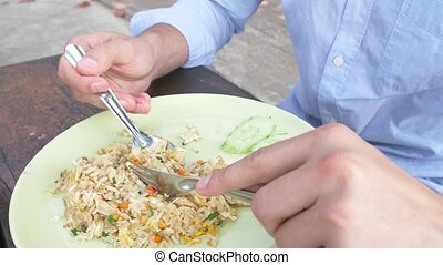 close-up. man squeezes lime juice on a dish with stir fried...