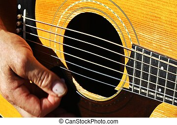 close-up:, man, strumming, guitar.