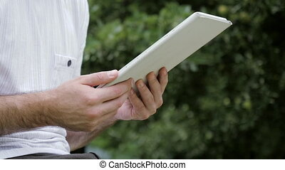 Man touching screen on modern digital tablet pc.