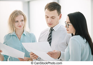 close up. Manager and employees discussing business documents