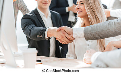 close up. Manager shaking the hand of the Bank customer