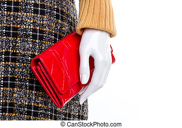 Close up mannequin hand with red wallet.