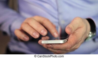 close-up man's hands using mobile phone touchscreen