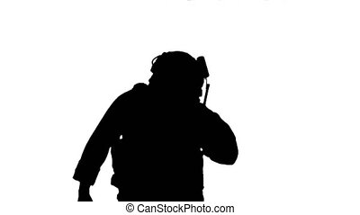 Close up. Marine walks, holds a radio station and gives orders, Alpha Channel Professional shot in 4K resolution. 048. You can use it e.g. in your medical, commercial video, business, presentation, broadcast