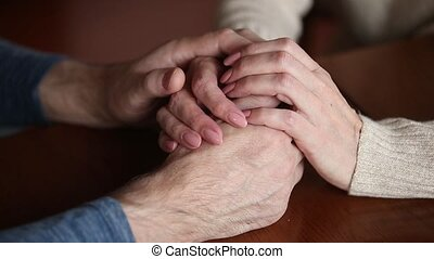 Close up mature couple woman and man holding hands - Close...