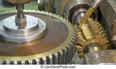 Close-up mechanism makes vertical grooves in pinion with...