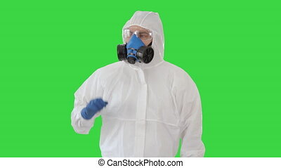 Close up. Medical doctor in hazmat clothes pointing on imaginary screen on a Green Screen, Chroma Key. Professional shot in 4K resolution. 53. You can use it e.g. in your medical, commercial video, business, presentation, broadcast
