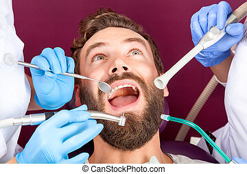 Close up men patient with open mouth in dental clinic