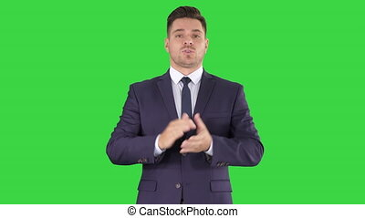 Close up. Meteorologist forecasting on a Green Screen, Chroma Key. Professional shot in 4K resolution. 014. You can use it e.g. in your commercial video, business, presentation, broadcast
