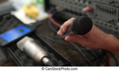 close-up. Microphone in the home studio. man singing karaoke...