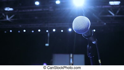 close up Microphone on Stage at conference, Spotlight, Backlight. Waiting For Performances. Seminar Conference Meeting Office Training Concept.