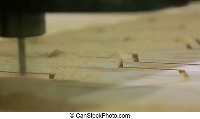 Close-up, milling machine automatically moves on the surface...