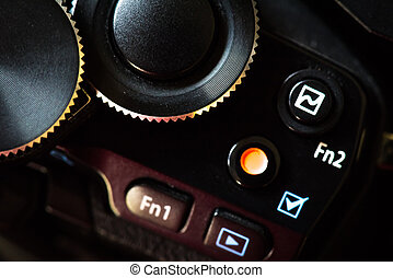 Close up Mirrorless micro 4/3 Digital Camera dial and function button. Digital Camera Technology concept.
